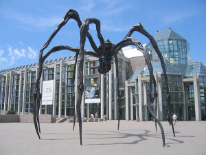 This spider wove the internet! No, really! And I'm its queen. (Photo by Kewima, sculpture outside Canadian Art Musuem, Ottawa.)